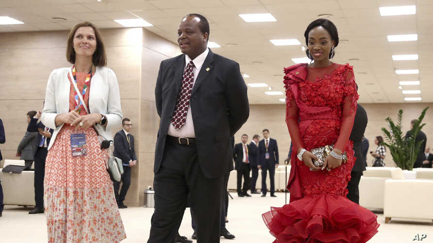 King Mswati III, of Swaziland and his wife, right, arrive to attend a welcome ceremony of the Russia-Africa summit in the Black Sea resort of Sochi, Russia, Oct. 23, 2019.