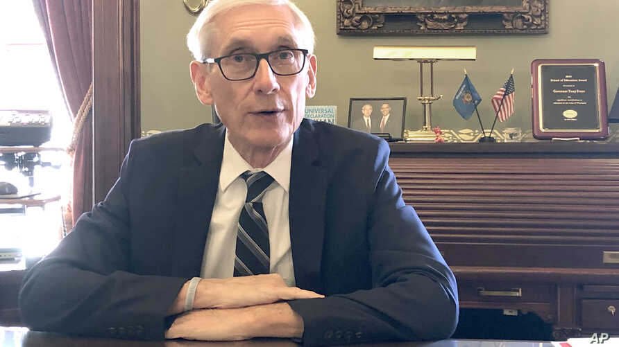 FILE - In this Dec. 19, 2019, file photo, Wisconsin Gov. Tony Evers sits for an interview with The Associated Press at his…