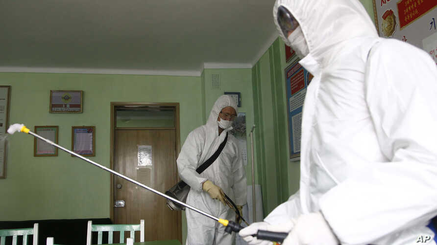 Offices at the Phyongchon District People's Hospital are disinfected to help curb the spread of the coronavirus on Wednesday,…