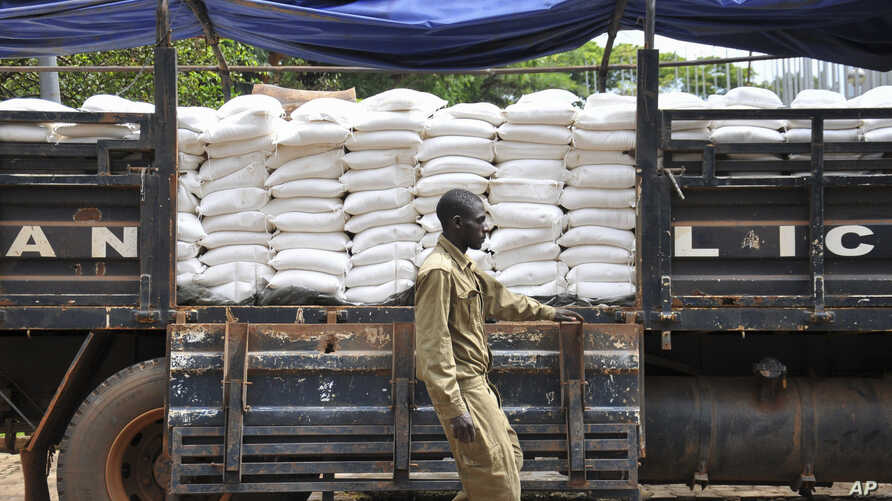 A truck of maize flour arrives to be distributed to people affected by the lockdown measures aimed at curbing the spread of the…