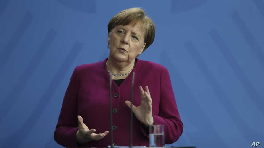 German Chancellor Angela Merkel briefs the media about measures of the German government to avoid further spread of the coronavirus at the chancellery in Berlin, Germany, Thursday, April 9, 2020.