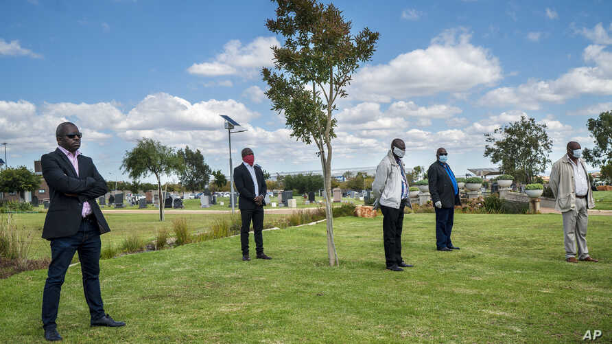 Family and friends observe social distancing during the funeral ceremony for Benedict Somi Vilakasi at the Nasrec Memorial Park…