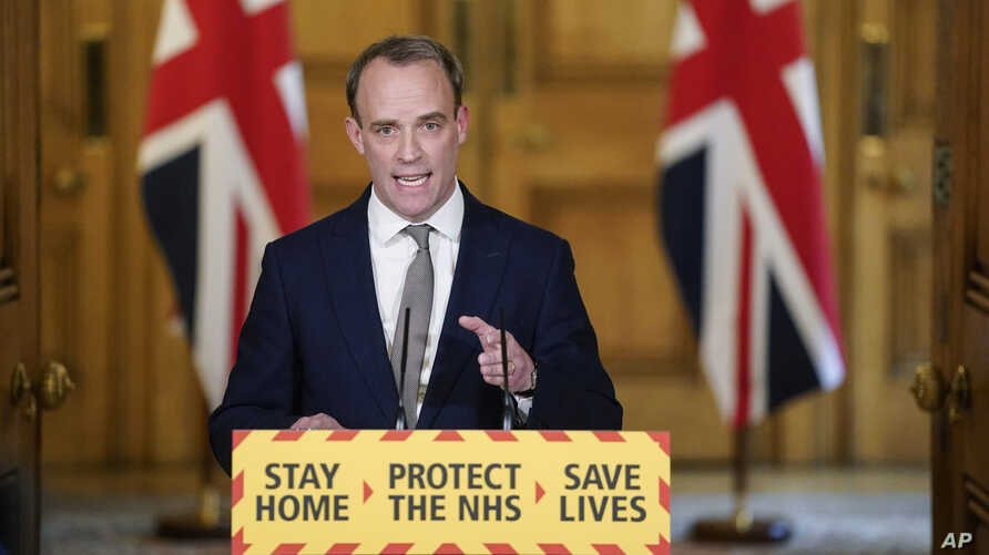 In this photo made available by 10 Downing Street, Britain's Foreign Secretary Dominic Raab gestures during a coronavirus media…