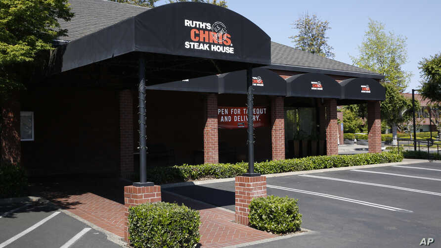 The Ruth's Chris Steak House is seen in Sacramento, Calif., Tuesday, April 21, 2020. The restaurant chain is among those…