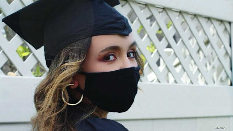 Isabella Pelletiere is pictured with face mask and graduation cap. (Courtesy - Isabella Pelletiere)