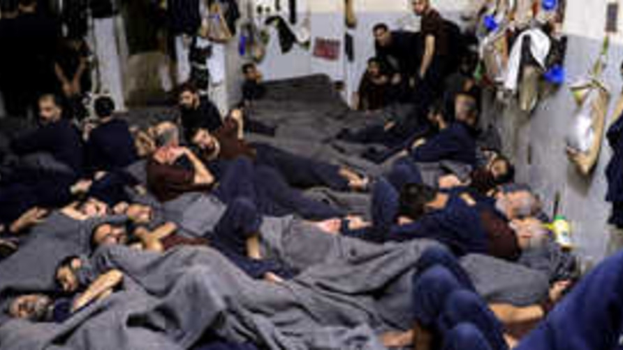 Foreign prisoners, suspected of being part of the Islamic State, lie in a prison cell in Hasaka, Syria, January 7, 2020…