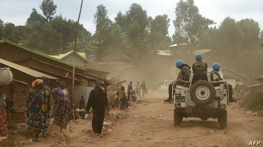 FILE - Moroccan soldiers from the U.N. mission in DRC (Monusco) patrol in the violence-torn Djugu territory, Ituri province, eastern Democratic Republic of Congo, March 13, 2019.