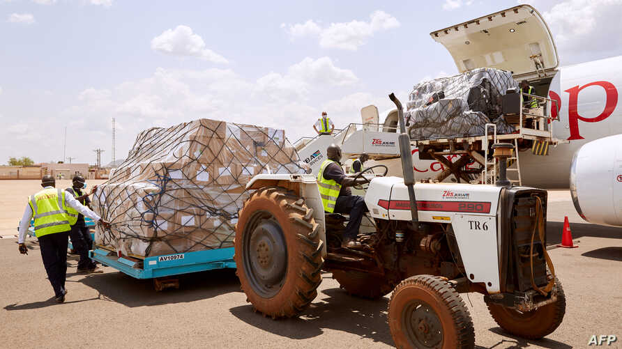 FILE - Airport staff unload cargo sent by Chinese billionaire Jack Ma and his Alibaba Group after it arrives at Juba International Airport, in Juba, South Sudan, March 24, 2020. African health officials say no supplies have reached Eritrea.