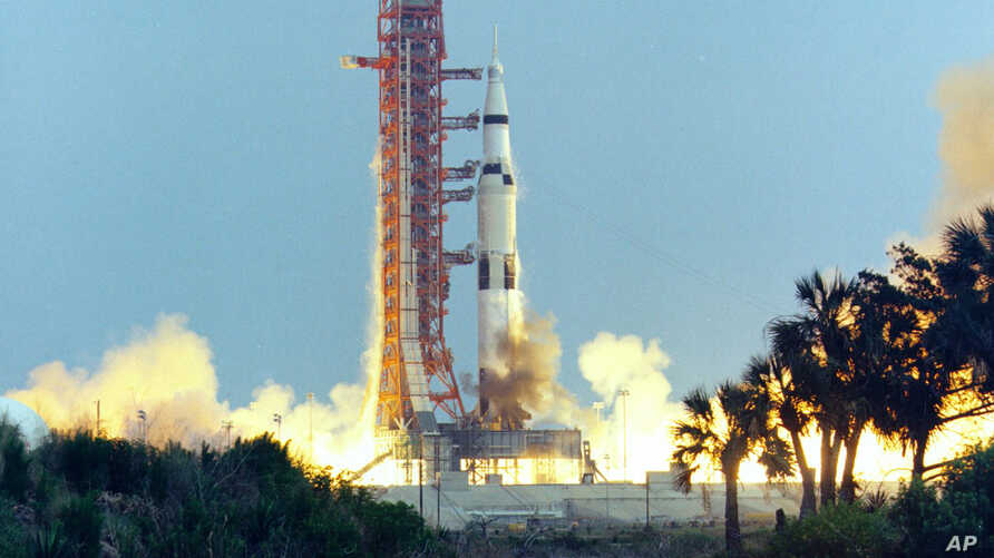 FILE - In this April 11, 1970, photo made available by NASA, the Saturn V rocket carrying the crew of the Apollo 13 mission to the moon launches from the Kennedy Space Center in Florida.
