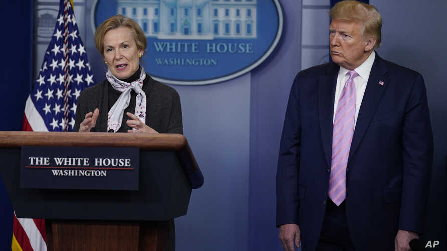 FILE - President Donald Trump listens as White House coronavirus response coordinator Dr. Deborah Birx speaks during a coronavirus task force briefing at the White House, in Washington, April 10, 2020.