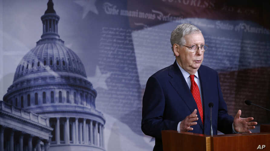 Senate Majority Leader Mitch McConnell of Ky., speaks with reporters after the Senate approved a nearly $500 billion coronavirus aid bill, April 21, 2020, on Capitol Hill in Washington.