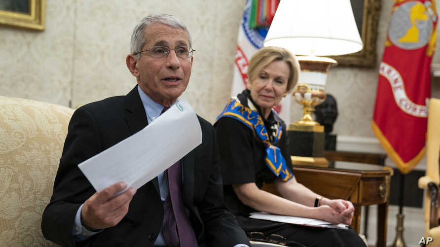 White House coronavirus response coordinator Dr. Deborah Birx listens as Director of the National Institute of Allergy and Infectious Diseases Dr. Anthony Fauci, left, speaks at the White House, April 29, 2020, in Washington.