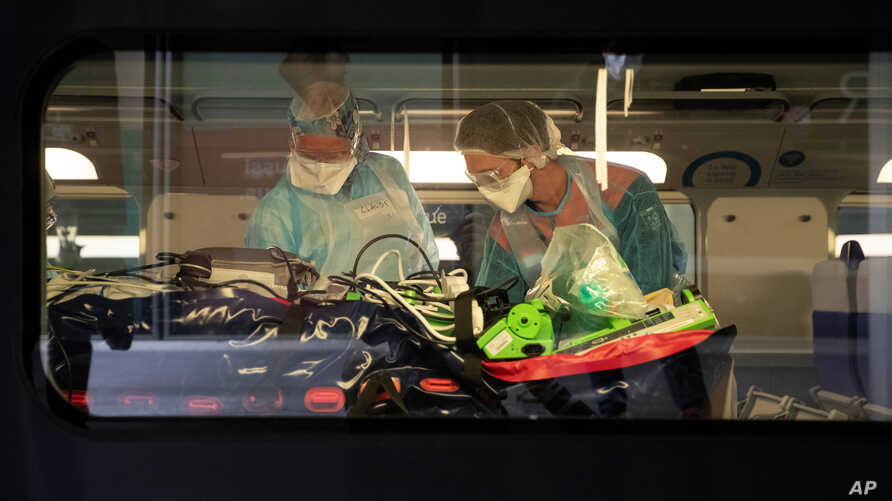 Medical staff take care of patients infected with the COVID-19 virus in a train at the Gare d'Austerlitz train station April 1, 2020 in Paris, France.