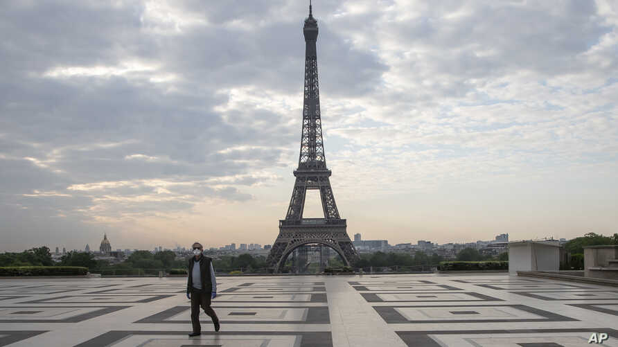 A man wears a mask to protect against the spread of the coronavirus as he walks along the Trocadero square close to the Eiffel Tower in Paris, France, April 25, 2020.