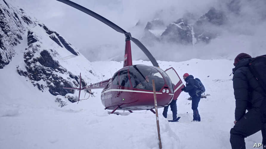 FILE- Trekkers are being rescued a day after an avalanche hit Mount Annapurna trail in Nepal, Jan. 18, 2020.