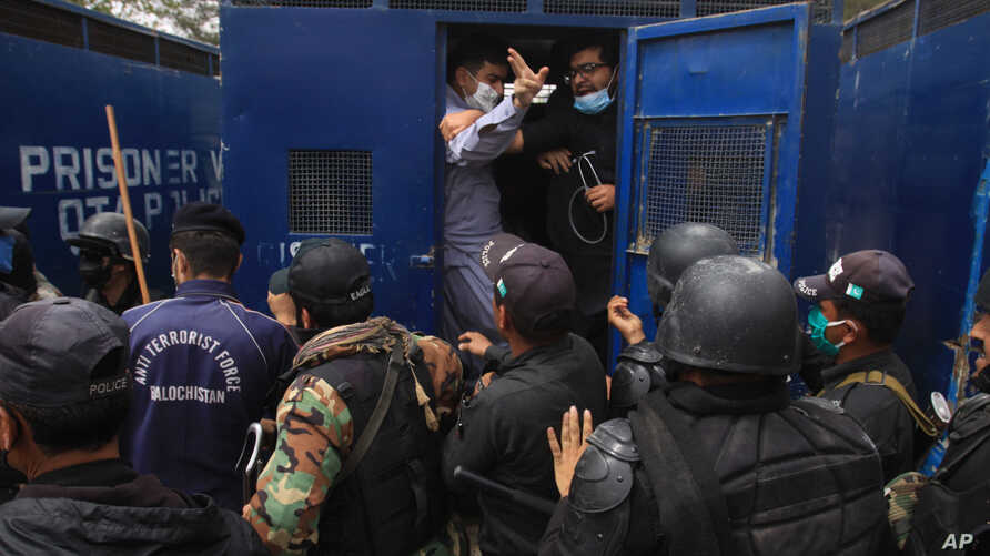 Police arrest doctors demanding facilities and prevention kits to attend to coronavirus patients, in Quetta, Pakistan.