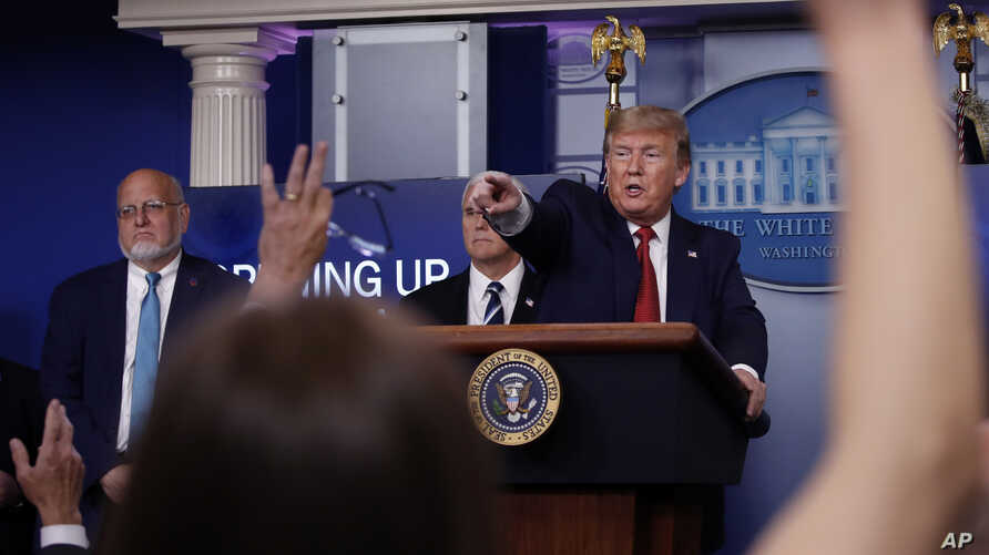FILE - President Donald Trump points to a reporter to ask a question as he speaks about the coronavirus in the James Brady Press Briefing Room of the White House, in Washington, April 16, 2020.