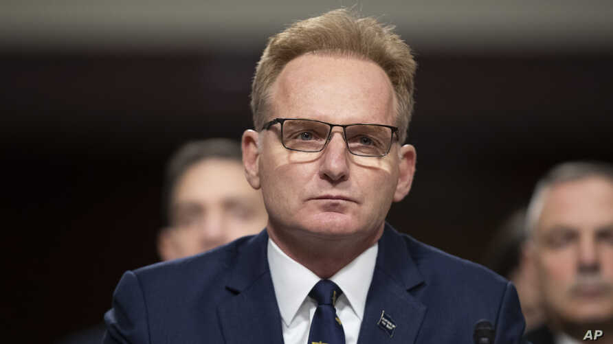 FILE- Acting Navy Secretary Thomas Modly testifies during a hearing of the Senate Armed Services Committee on Capitol Hill in Washington, Dec. 3, 2019.