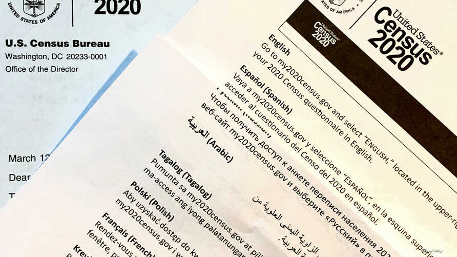 A 2020 census letter and a multilingual guide mailed to a U.S. resident in Fairfax, Virginia, March 12, 2020. (Photo: Diaa…