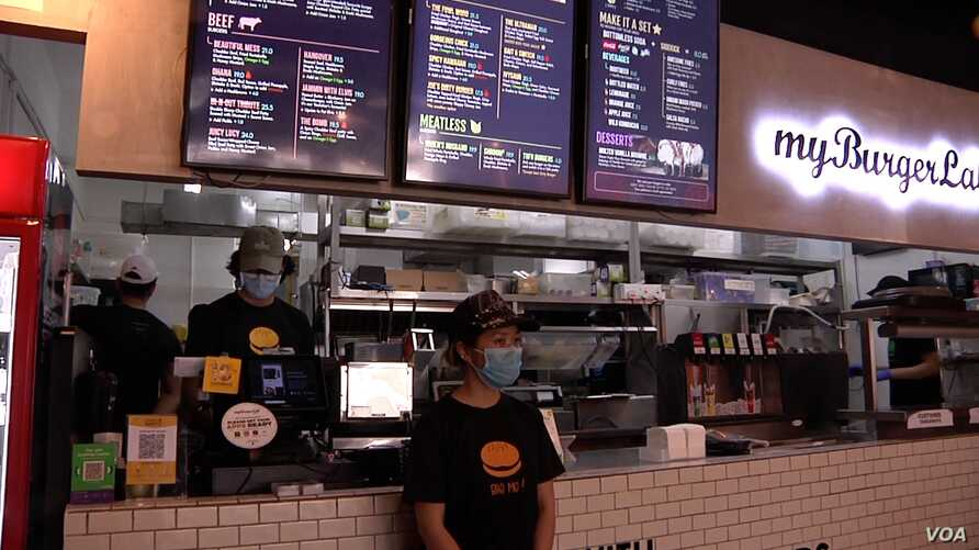 The Malaysian government's stimulus will pay a portion of the salaries for some of myBurgerLab's employees. (Dave Grunebaum/VOA)