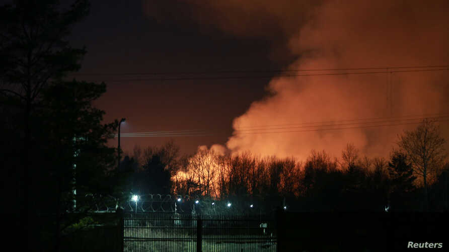 Smoke is seen rising from a fire that broke out at a penal colony after a riot by inmates, in Angarsk, Russia, April 11, 2020.