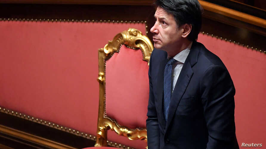 FILE - Italian Prime Minister Giuseppe Conte stands during a session in the Senate, the upper house of parliament, on the spread of coronavirus, in Rome, Italy, March 26, 2020.
