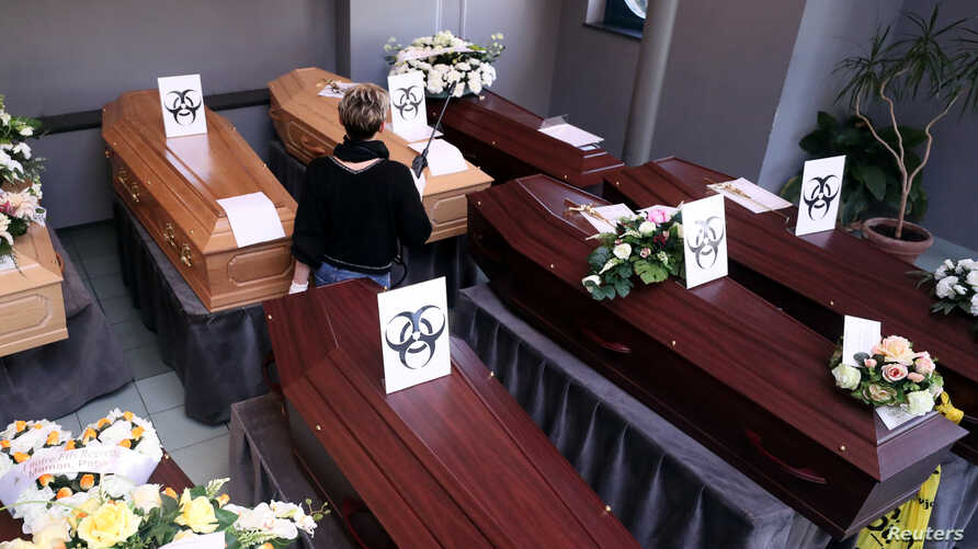 Biohazard warning signs are placed on the coffins of people who died of the coronavirus disease (COVID-19), at a mortuary near the city of Charleroi, Belgium.