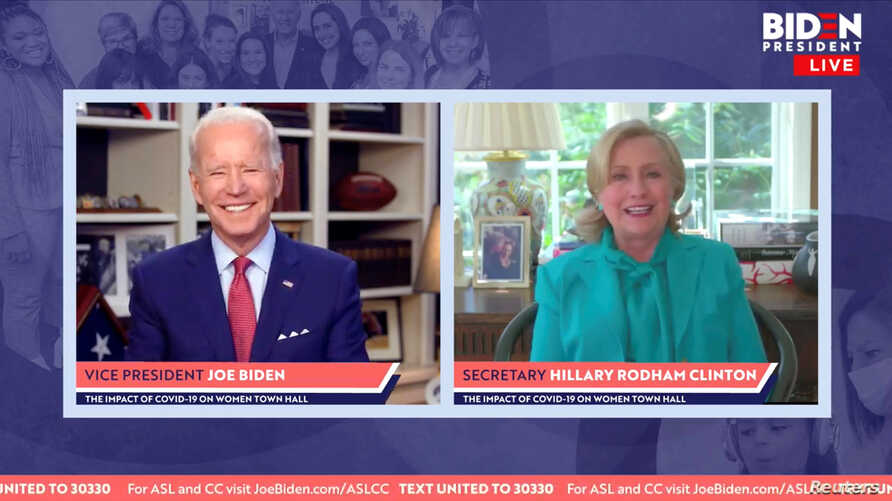 Democratic U.S. presidential candidate Joe Biden smiles as former Secretary of State Hillary Clinton endorses him for president in a video screengrab made during an online town hall, in Wilmington, Delaware, April 28, 2020. (Biden For President/Handout)