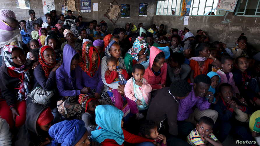 Eritrean refugees wait to get registered on arrival at the Indabaguna refugee reception and screening center in Tigrai region near the border in Ethiopia, Feb. 9, 2016.