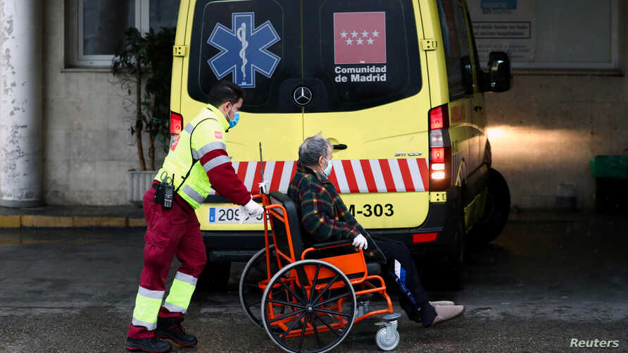 An ambulance worker arrives with a patient at the 12 de Octubre Hospital, amid the coronavirus disease (COVID-19) outbreak, in Madrid, Spain, March 31, 2020.
