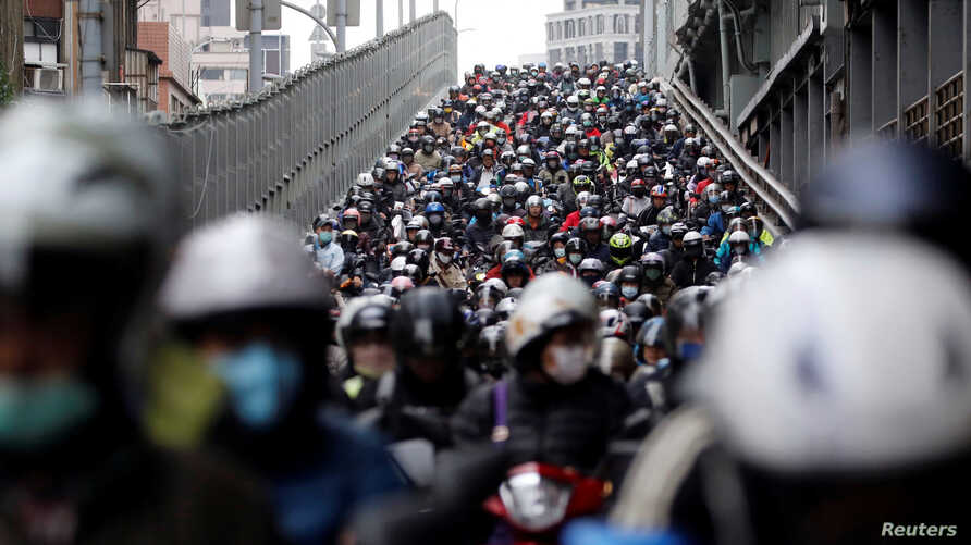 Commuters wear face masks to protect themselves from the coronavirus disease (COVID-19) spread during morning rush hour traffic in Taipei, Taiwan.