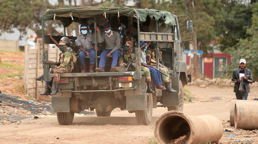 Police and soldiers patrol the streets during a nationwide lockdown to help curb the spread of the coronavirus disease (COVID-19) in Harare, Zimbabwe, April 19, 2020.