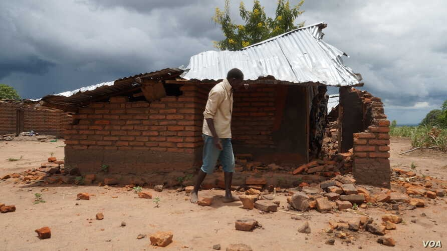 FILE - Angry villagers in Phalombe district destroyed this house  in 2018 after accusing its owners of withholding rains through magic. The existence of vampires is another common superstition in Malawi. (Lameck Masina/VOA)