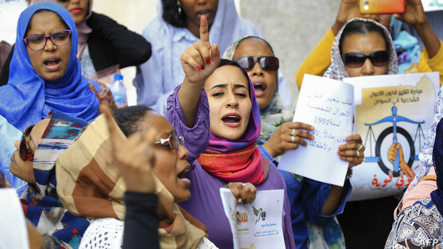 Women chant slogans during a demonstration calling for the repeal of family law in Sudan, on the occasion of International…