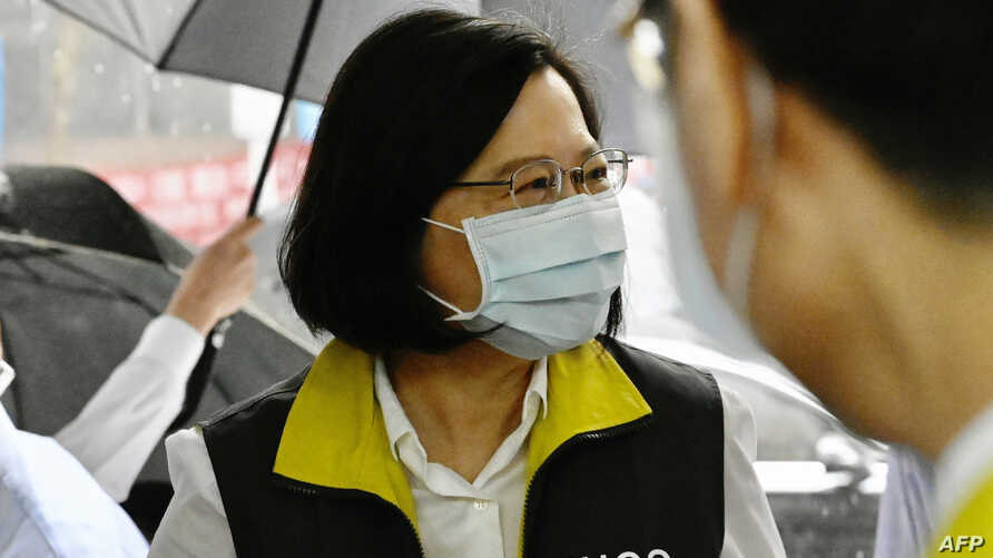 Taiwan President Tsai Ing-wen arrives during her visit to the Centers for Disease Control (CDC) in Taipei on May 19, 2020. -…