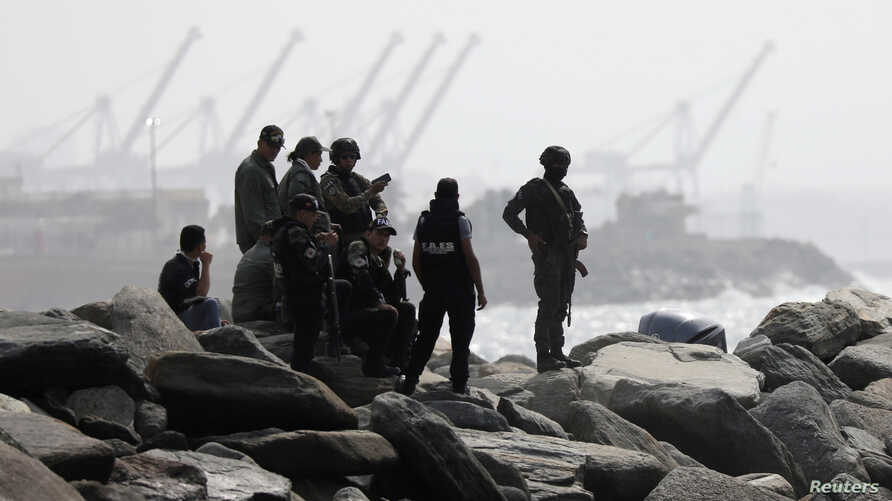 "FILE PHOTO: Members of the special forces unit are seen at a shore, after Venezuela's government announced a failed ""mercenary""…"
