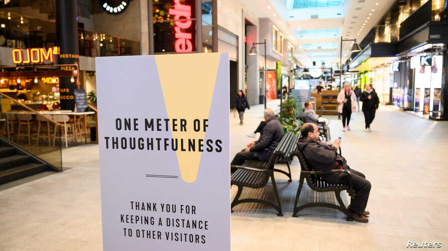 A sign promoting social distancing is pictured in the Gallerian shopping center, as the spread of the coronavirus disease …
