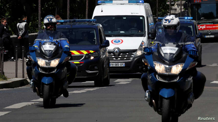 A police convoy believed to be carrying Rwandan genocide fugitive Felicien Kabuga arrives at the Paris courthouse where Kabuga…