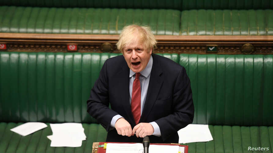 Britain's Prime Minister Boris Johnson speaks at the House of Commons during question period, amid the coronavirus disease…