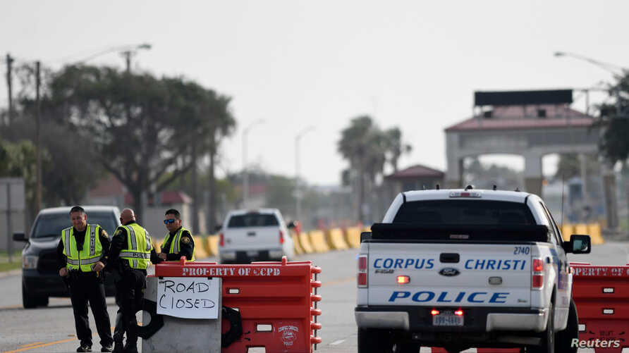 Police officers stand at a checkpoint after a shooting incident at Naval Air Station Corpus Christi, Texas, U.S. May 21, 2020…