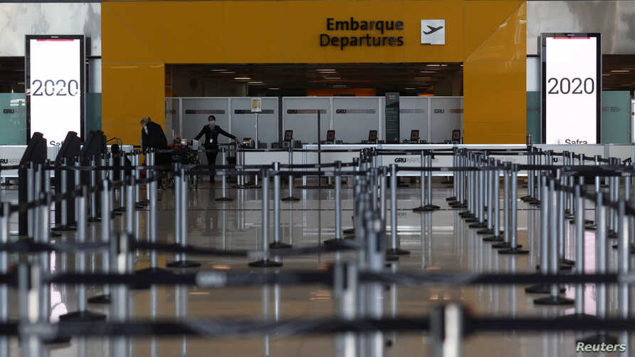 An empty airline check-in hall is seen at Guarulhos International Airport amid the outbreak of the coronavirus disease (COVID…