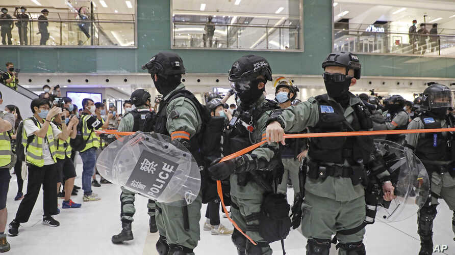 Riot police enter the shopping mall to disperse the protesters during the Labor Day in Hong Kong, May 1, 2020.