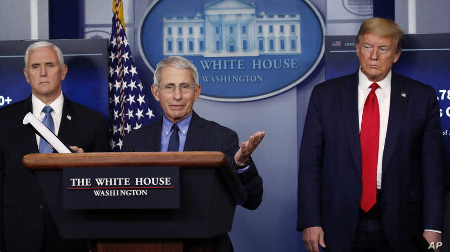 FILE - President Donald Trump and Vice President Mike Pence listen as Dr. Anthony Fauci, director of the National Institute of Allergy and Infectious Diseases, speaks about the coronavirus in the James Brady Press Briefing Room of the White House in Washington.