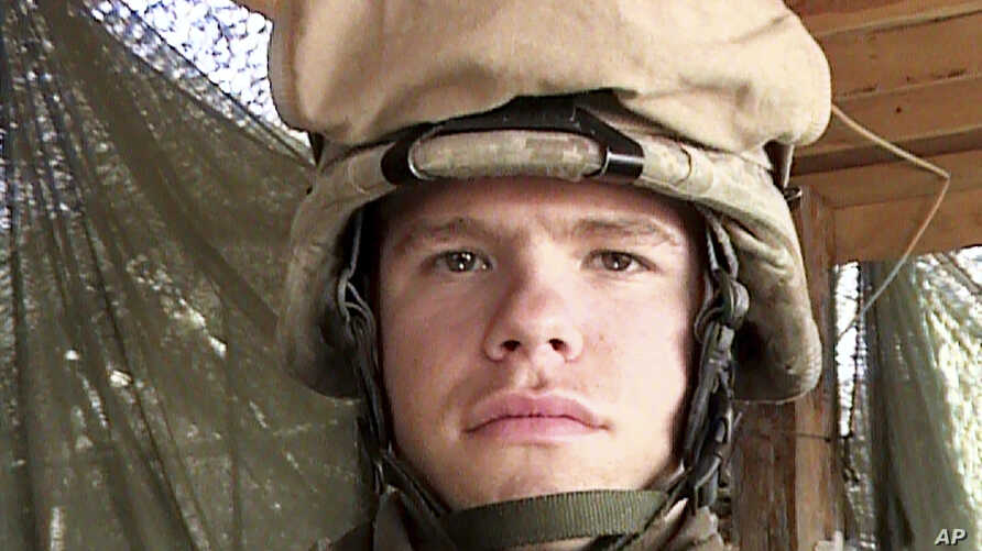In this April 13 2006, photo, provided by the Lucas family, Marine Lance Cpl. Kevin Adam Lucas poses while serving in Anbar