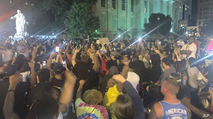 In a photo provided by Jada W., protesters gather Thursday, May 28, 2020, in downtown Louisville, Ky., against the police shooting of Breonna Taylor, a black woman fatally shot by police in her home in March.