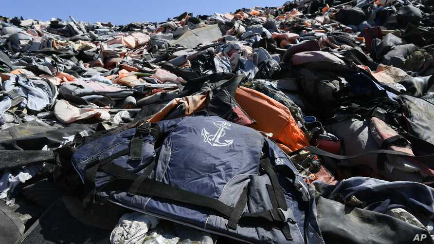 Piles of life jackets used by refugees and migrants lie at a dump in Molyvos village, on the northeastern Aegean island of…