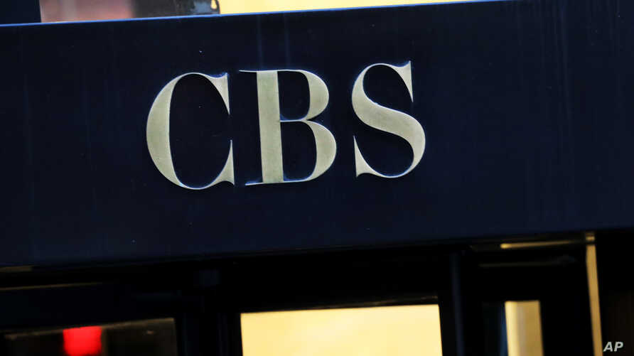 FILE - This Dec. 6, 2018, file photo shows the CBS logo at the entrance to its headquarters, in New York. The CBS game …