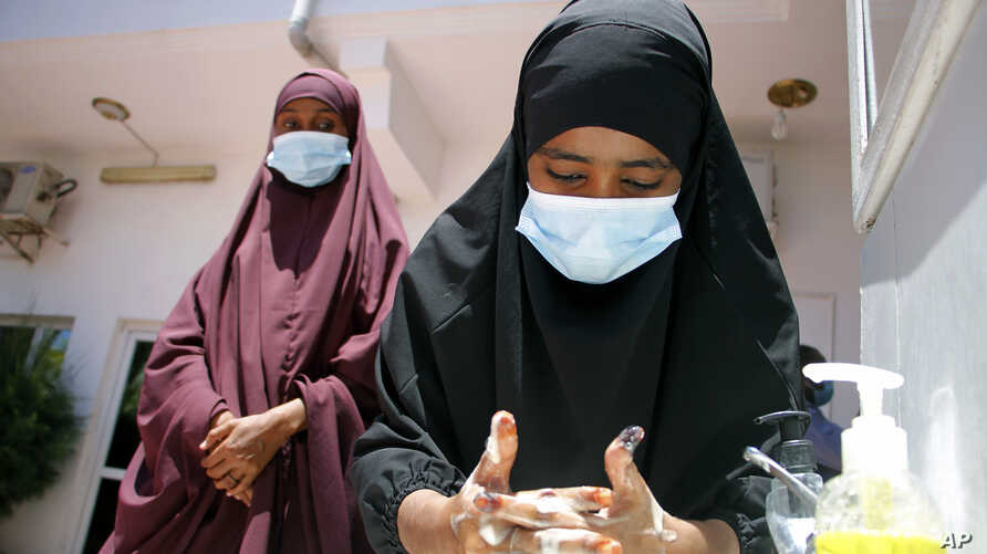 Somali female wash their hands during coronavirus awareness training conducted by the local paramedics and doctors in Somali…