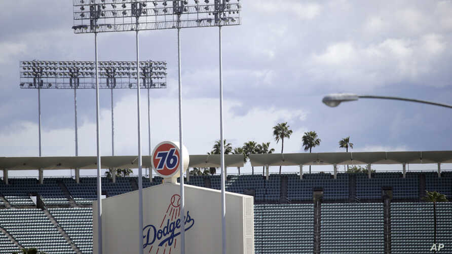 FILE - The exterior of Dodgers Stadium, home of the Los Angeles Dodgers is seen Wednesday, March 25, 2020, in Los Angeles.