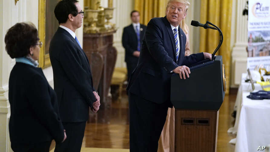 President Donald Trump speaks during an event about the Paycheck Protection Program used to support small businesses during the…